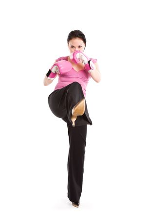 tough: A businesswoman wearing boxing gloves and kicking