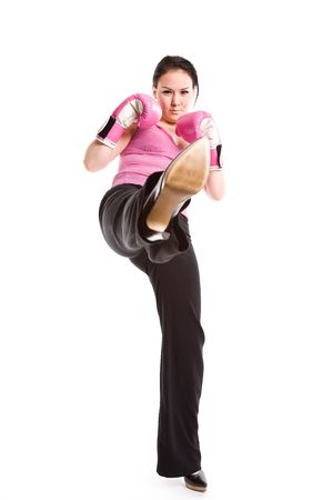 A businesswoman wearing boxing gloves and kicking Stock Photo - 3599181