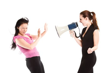 toward: An angry businesswoman shouting toward her colleague using a megaphone Stock Photo