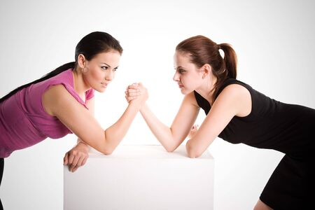 An shot of two businesswomen arm wrestling photo