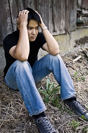 A shot of a stressed young asian male Stock Photo - 3606263