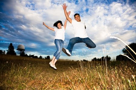 A shot of a happy asian couple jumping for joy Imagens