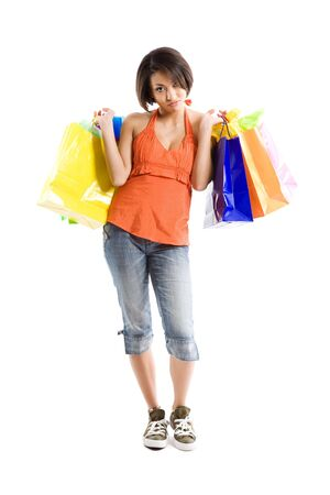An isolated shot of a black woman with tired look carrying shopping bags Stock Photo - 3616557