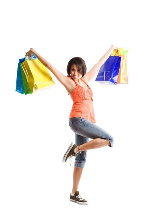 An isolated shot of a black woman carrying shopping bags Stock Photo - 3616555