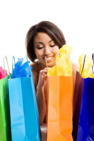 An isolated shot of a beautiful black woman looking at her shopping bags photo