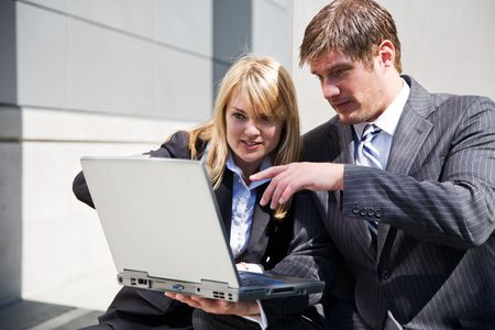 Two working caucasian business people having a discussion Stock Photo - 3624641