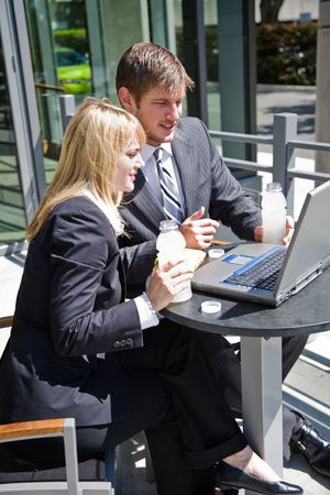 Two caucasian business people having a discussion during lunch hour Stock Photo - 3624642