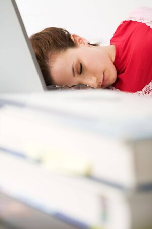 taking nap: A caucasian female student falls asleep while studying