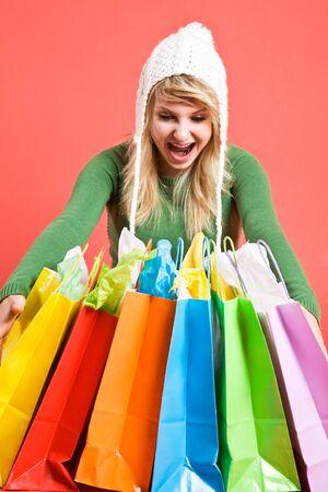 A happy beautiful caucasian girl holding shopping bags Stock Photo - 3643235