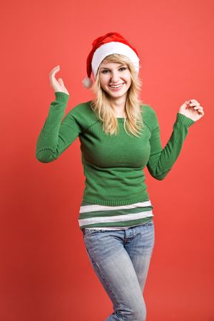 wearing santa hat: A beautiful and happy caucasian girl wearing santa hat Stock Photo