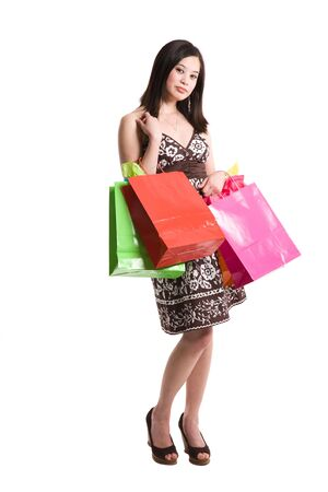 An isolated shot of a beautiful asian woman carrying shopping bags Stock Photo - 3671839
