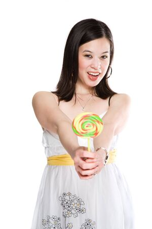 A beautiful asian woman holding a colorful lollipop photo