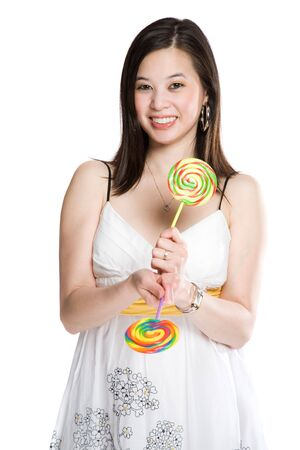 A beautiful asian woman holding two lollipops photo