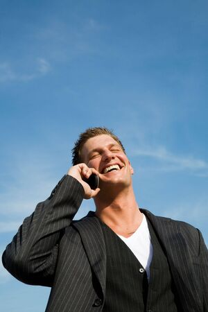 A caucasian businessman talking on the phone outdoor Stock Photo - 3675219