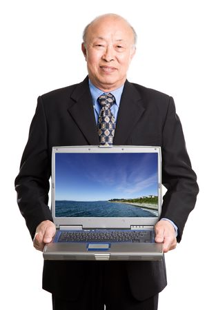 An isolated shot of a senior asian businessman carrying a laptop (Note: image on the laptop is taken by me) photo