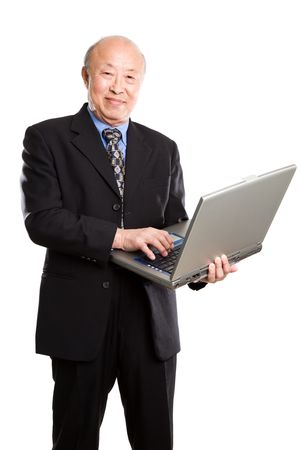 A senior asian businessman holding a laptop photo
