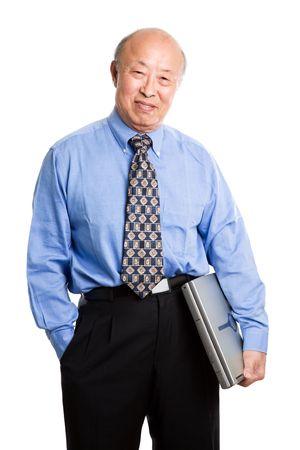 A senior asian businessman holding a laptop photo