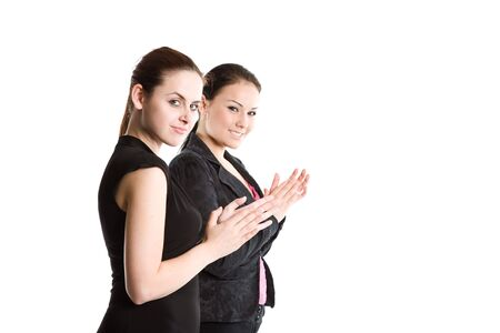 Two businesswomen in a meeting clapping hands photo