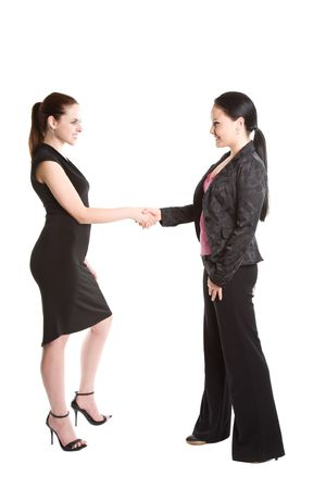 An isolated shot of two businesswomen shaking hands photo