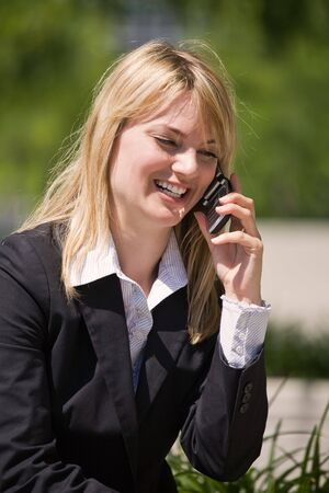 A caucasian businesswoman talking on the phone photo