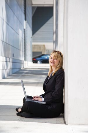 A caucasian businesswoman working on her laptop outdoor Stock Photo - 3720716