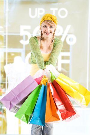 A beautiful caucasian girl carrying shopping bags photo