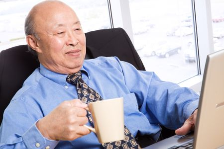 and the horizontal man: A senior asian businessman working in the office Stock Photo
