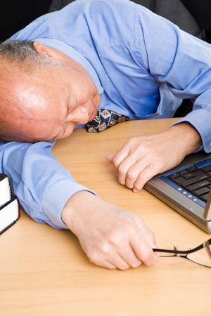 A senior asian businessman sleeping in the office Stock Photo - 3805174
