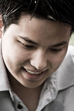 A portrait of a happy young asian male photo