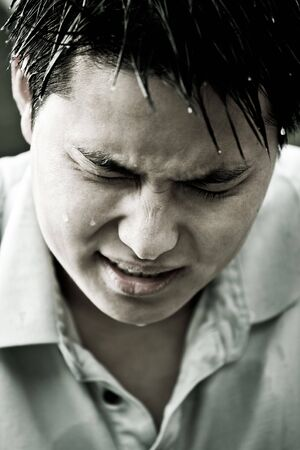 A portrait of a sad and depressed young asian man  Stock Photo