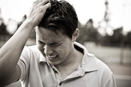 upset man: A sad and stressed young asian male in black and white Stock Photo