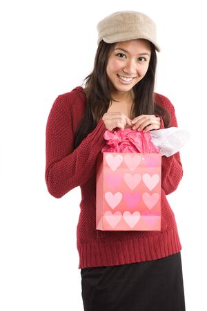 A beautiful asian girl receiving a valentine gift photo