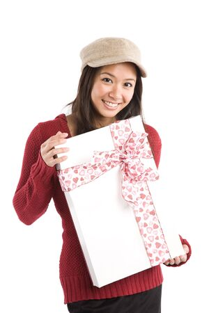 A beautiful asian girl holding a valentine gift Stock Photo - 3857695