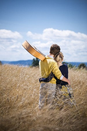 A young caucasian couple in love enjoying the beautiful nature outdoor Stock Photo - 4202623