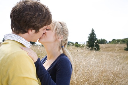 A young caucasian couple in love kissing outdoor  Imagens
