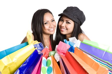 An isolated shot of a beautiful asian woman carrying shopping bags photo