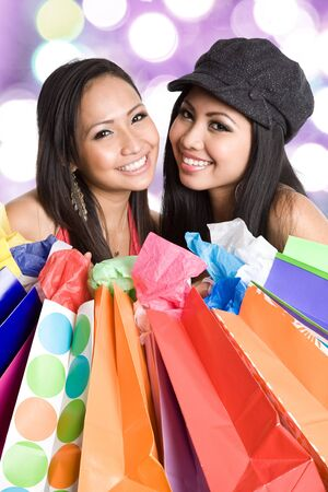 shopaholics: An shot of a beautiful asian women carrying shopping bags