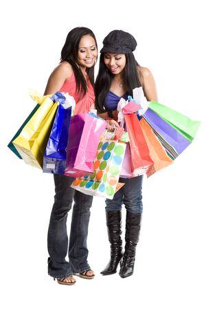 An isolated shot of two beautiful asian women carrying shopping bags photo