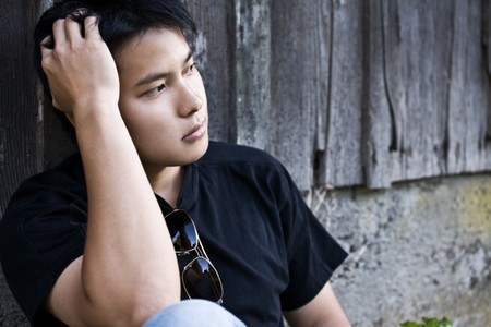A shot of a stressed asian male outdoor Stock Photo - 4294984