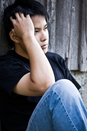 Een shot van een gewezen Aziatische mannen buitenshuis Stockfoto - 4294985
