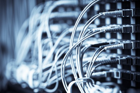 A shot of network cables connected to routers in a data center Stock Photo - 4341175