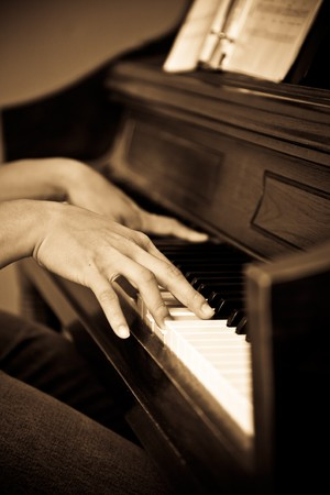 A shot of a man playing piano photo