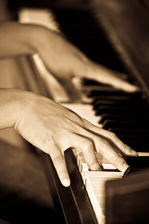 A closeup shot of a man playing piano photo