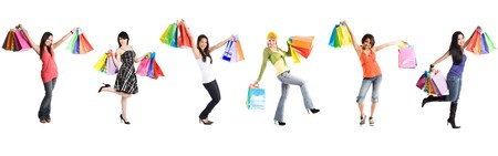 shoppers: A group of multi ehtnic women carrying shopping bags Stock Photo