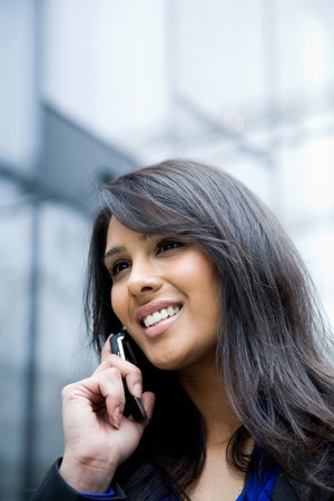 A shot of an indian businesswoman talking on the phone  outdoor Stock Photo - 4443721