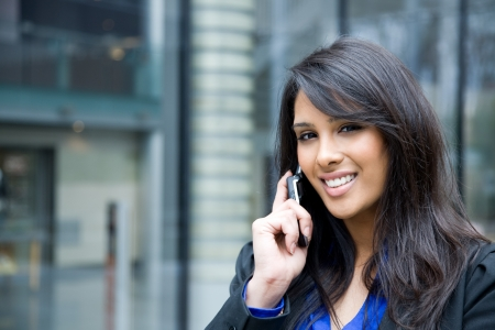 A shot of an indian businesswoman talking on the phone  outdoor