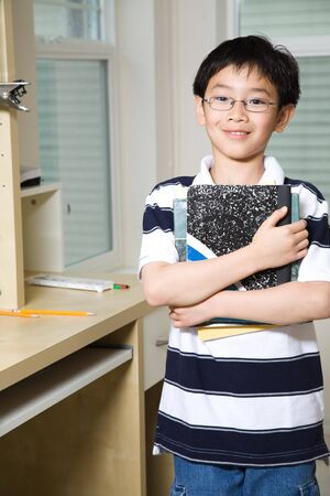 assignments: A shot of an asian kid studying at home Stock Photo