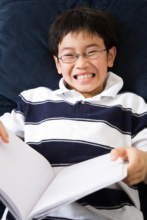 kid reading: A shot of an asian kid studying at home Stock Photo