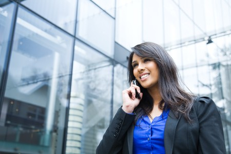 A shot of an indian businesswoman talking on the phone  outdoor Stock Photo - 4569177