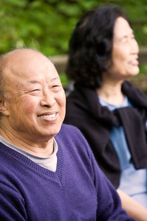 A shot of happy elderly asian couple outdoor photo